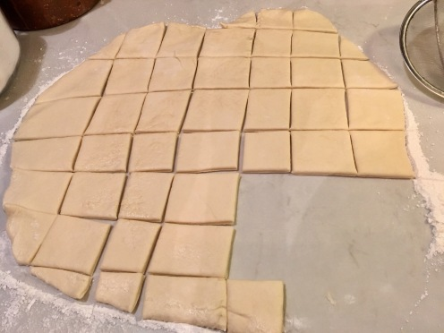 Roll to 1/4 in thickness. Cut into squares.